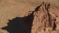 8k fly over rock formation in painted desert