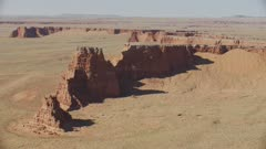 8k wide aerial red rock formations in painted desert