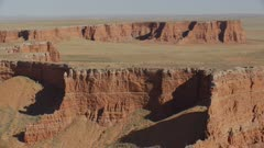 8k wide aerial red rock canyons and cliffs in painted desert
