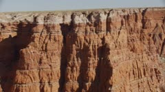 8k aerial red rock canyons and cliffs in painted desert