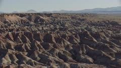 8k aerial desert landscape painted desert layered cliffs