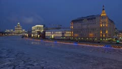 Moscow Russia City View at Night on River with drifting ice, and Stalin's High Building