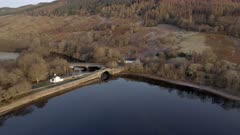 Old Bridge and Keeper's House on a Loch in Scotland