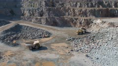 Large Vehicles Working Around a Large Open Quarry