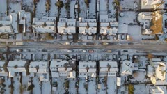 Snowy Streets and Houses in the Early Morning Bird's Eye View