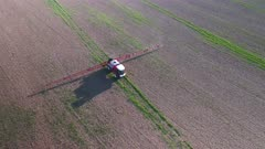 Tractor Spraying Fields on an Arable Farm with Glyphosate Herbicide