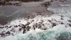 Bird's Eye View of Waves Crashing on a Rocky Coast