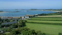 Green Countryside Next to a Port on the Isles of Scilly