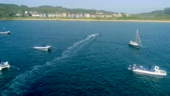 Kitesurfer Amongst Yachts in a Bay