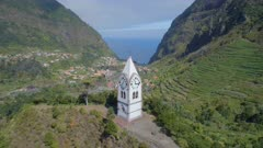 Beautiful Old Clock Tower on a Hill in Madeira with the Valley in the Distance