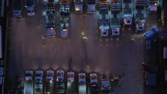 Aerial View of Roadworks Depot at Night With Vehicles and Workers