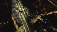 Aerial Time Lapse of a Train Station at Night