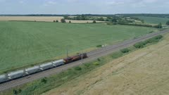 Low Level View of Two Passing Commuter Trains