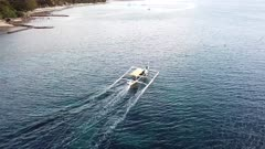 Aerial Banca boat traveling in the Philippines