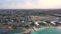 Aerial view over the island of Curaçao / Caribbean Sea with turquoise water, cliff, beach and beautiful coral reef