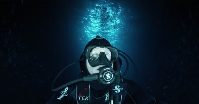 portrait of diver in deep with sun behind