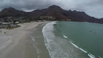 Scenic view of a beach and surrounding mountains at Hout Bay near Cape Town, South Africa