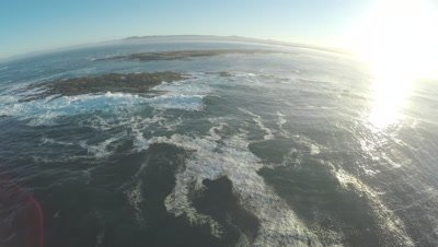 Aerial shot of Geyser Rock's Brown Fur Seal colony and Dyer Island at sunset, off the South African coast