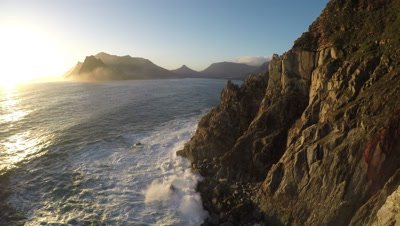 Scenic view of the coastal cliffs near Hout Bay, South Africa, at sunset