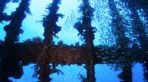 Synchronous Glassy Sweepers Around Wreck Structures