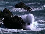 Waves Crash On Rocks At Shore