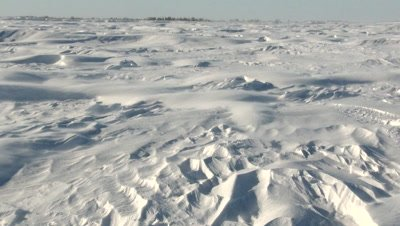 Severe wind blowing snow over Tundra in high Arctic