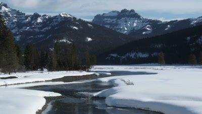 Rippling river in snow covered Lamar Valley