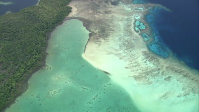 Flying over shallow reef and coastline