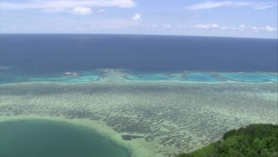 High angle view of shallow reef near coastline