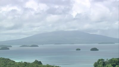 view of cloud covered mountain on island