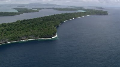 Flying above rocky coastline on island