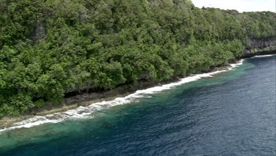 Flying along steep, rocky coastline