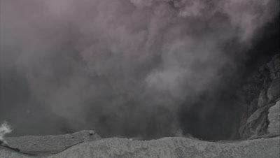 zoom out from smoking volcano
