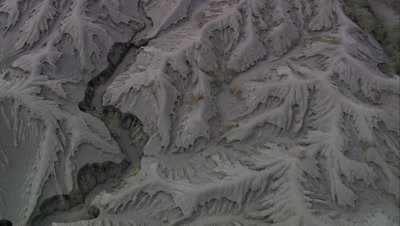 High angle view of terrain below, patterns of volcanic ash