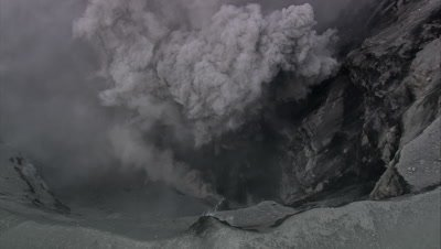 zoom out on smoking volcano crater