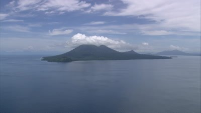 View of island with cloud covered mountain