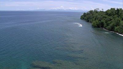 flying along island's coastline