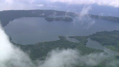 Island below clouds, tilt down