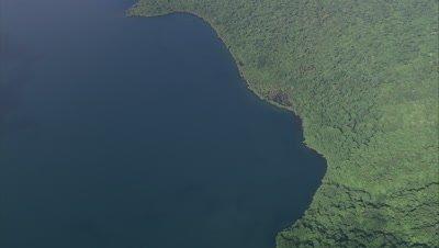 High angle view of island coast, tilt up to reveal more coastline