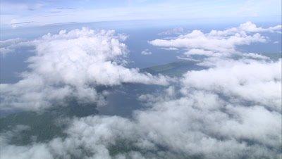 Island and coast below clouds
