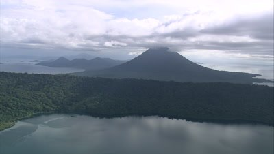 View of island coast, mountain in background