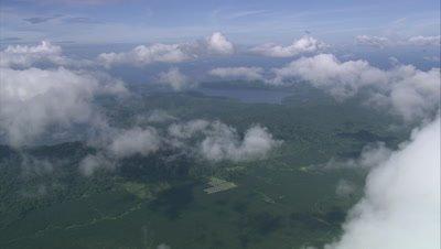 Palm Oil plantation below clouds