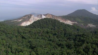 flying over mountain to reveal sulphur springs and tilt down