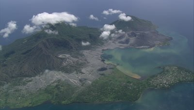 Flying over an island with a volcano