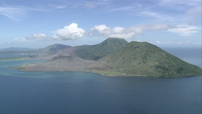 Approaching island with volcano