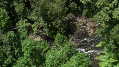 Flying above island, circling around secluded waterfall