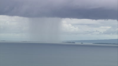 View of island with rain storm in distance