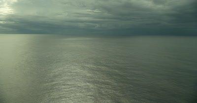 Ocean horizon. Nice shine on water. Tracking left