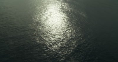 Ocean horizon, with sun reflection off surface