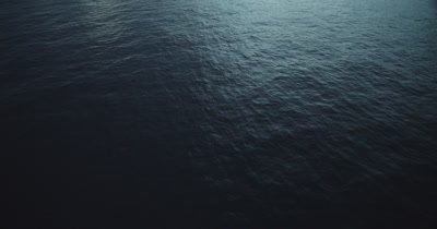 High Angle of calm ocean in low, early morning light.